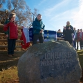 Mayor Ann Williams, Iolo Williams and Richard Kretchmer behind the stone